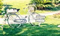 Old white wedding bicycle on green garden near flowers Royalty Free Stock Photo