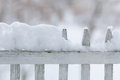Old white wooden fence covered with snow winter seasonal specific wood fresh on season Stock Image