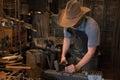 Old Wild West Blacksmith Hammering Royalty Free Stock Photo