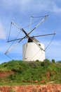 Old windmill in algarve portugal an rundown with no sails europe Stock Photo