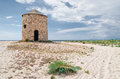 Old windmill on the beach Royalty Free Stock Photo