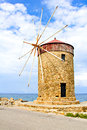 Old windmill on the island of rhodes at mandraki harbor greece Royalty Free Stock Image