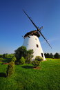 Old windmill in the light of the setting sun. Royalty Free Stock Photo