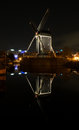 Old windmill night reflection Royalty Free Stock Photo