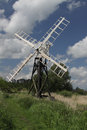 Old windmill norfolk broads wooden on the banks of the canal system Stock Photo