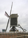 Old windmill and pierl in Heusden. Royalty Free Stock Photo