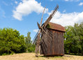 Old windmill on rural meadow Stock Photo