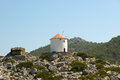 Old windmill on the shore of one of the greek islands of the dodecanese in the aegean sea greece Royalty Free Stock Photography