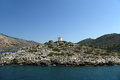 Old windmill on the shore of one of the greek islands of the dodecanese in the aegean sea greece Royalty Free Stock Images