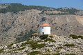 Old windmill on the shore of one of the greek islands of the dodecanese in the aegean sea greece Stock Photography