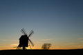 Old windmill silhouette by sunset Royalty Free Stock Photo