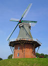 Old windmill an under a blue sky Royalty Free Stock Photos