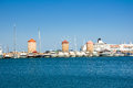 Old windmills in harbour of Rodes, Greece Royalty Free Stock Photo