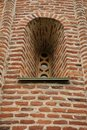 stock image of  Old window in an ancient monastery wall close up. narrow window in old european fortress
