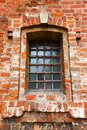 Old window with bars in a red brick see my other works portfolio Stock Image