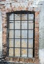 Old window in an old brick wall, Window with grid