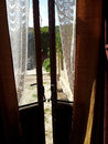 Old window with curtains in a sicilian home italy Stock Photo