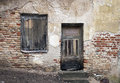 Old window and door with cracked wall Royalty Free Stock Photo