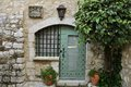 Old window and door of medieval house under tree on the alley city south france Royalty Free Stock Images