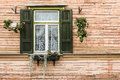 Old window with flowers in riga Stock Photo