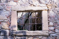 Old window grille of a ruined castle Royalty Free Stock Photo