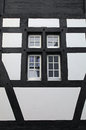 Old window of a medieval house switzerland facade and half timbered vertical image Stock Image