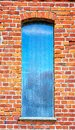 Old window in a red brick wall Royalty Free Stock Photo