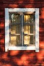 Old window in red wooden house see my other works portfolio Stock Image