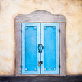Old window in a rural tuscan house with colorful plaster Royalty Free Stock Photo
