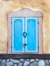 Old window in a rural tuscan house with colorful plaster Royalty Free Stock Image