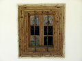 Old window with trellis in a village Royalty Free Stock Images