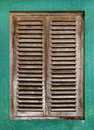 Old window with wooden lattice vintage on green wall Royalty Free Stock Photo