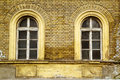 Old window yellow brick build house Royalty Free Stock Images