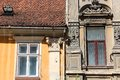 Old windows in romania brasov town transylvania town architecture Stock Photos