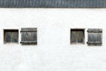 Old windows and shutters in an Austrian castle wall Royalty Free Stock Photo