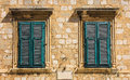 Old windows with shutters, Dubrovnik, Croatia Royalty Free Stock Photo