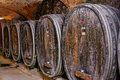 Old wine cellar with barrels an wooden Royalty Free Stock Image