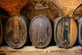 Old wine cellar with barrels an wooden Stock Photo