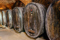 Old wine cellar with barrels an wooden Royalty Free Stock Photos