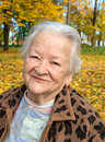 Old woman in autumn park portrait of Royalty Free Stock Photo