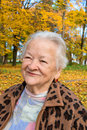 Old woman in autumn park portrait of Royalty Free Stock Image