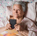 Old woman with Bible Royalty Free Stock Photo