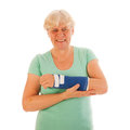 Old woman with broken wrist in gypsum Royalty Free Stock Photo