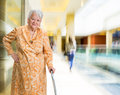 Old woman with a cane Royalty Free Stock Photo