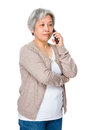 Old woman chat on cellphone Royalty Free Stock Photo