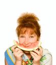 Old Woman eat watermelon Stock Photography