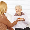 Old woman eating breakfast happy women in a nursing home Royalty Free Stock Photo