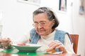 Old woman eating her lunch at home Royalty Free Stock Images