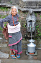 Old woman getting water Royalty Free Stock Photo