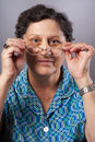 Old woman with glasses Royalty Free Stock Images